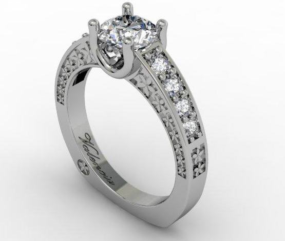 Solitaire diamond ring with small diamonds both sides